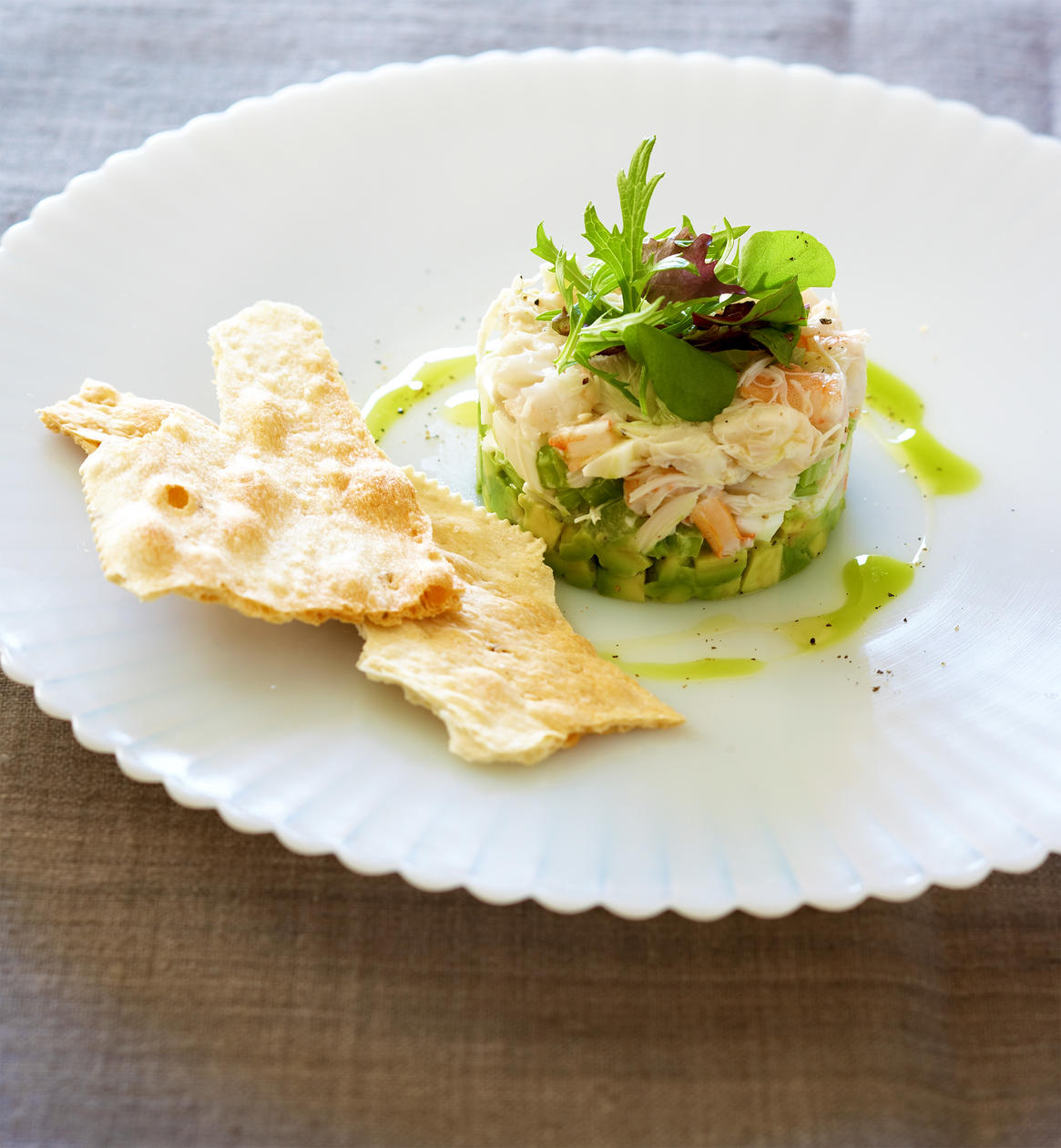 green oil on plate of lumb crab and shrimp